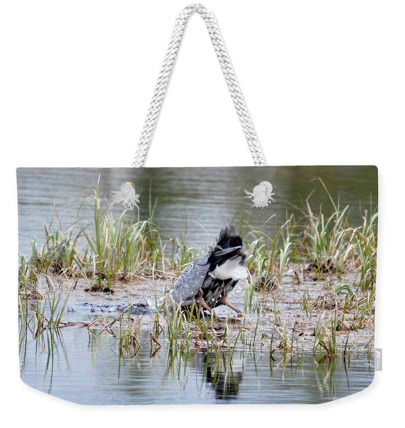 Great Blue Heron Weekender Tote Bag featuring the photograph Got It by Thomas Phillips