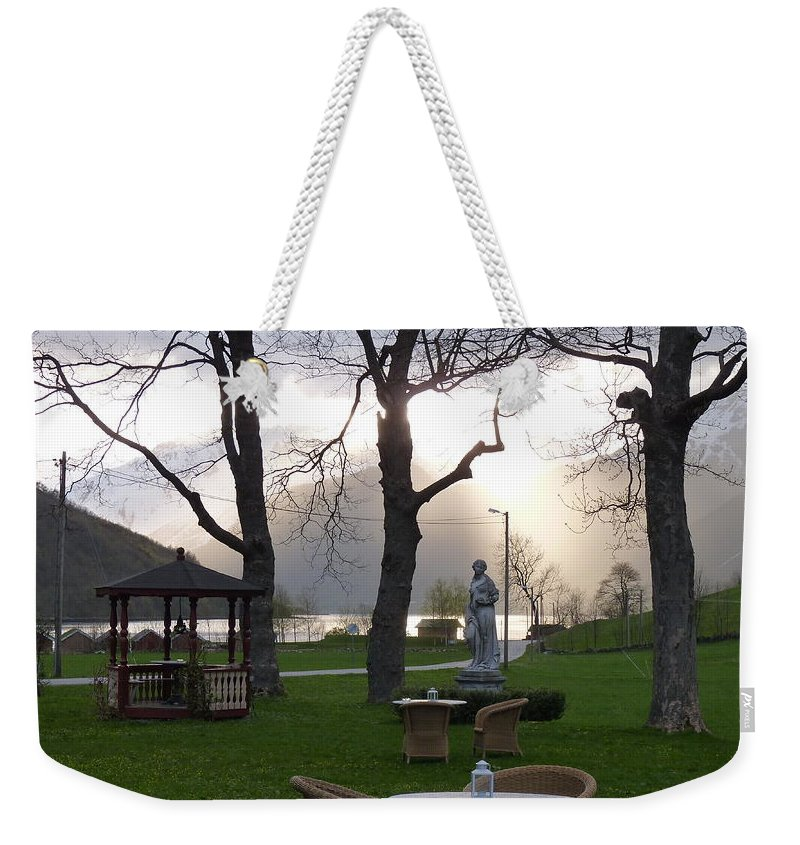 Weekender Tote Bag featuring the photograph Gracing The Sun by Katerina Naumenko
