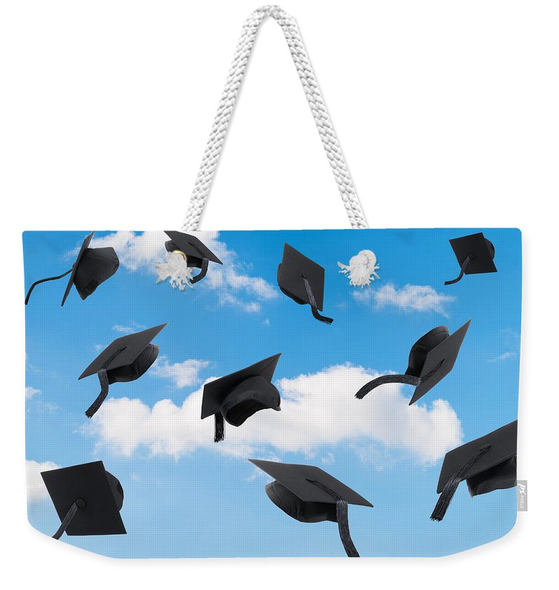 Graduation Weekender Tote Bag featuring the photograph Graduation Mortar Boards by Amanda Elwell