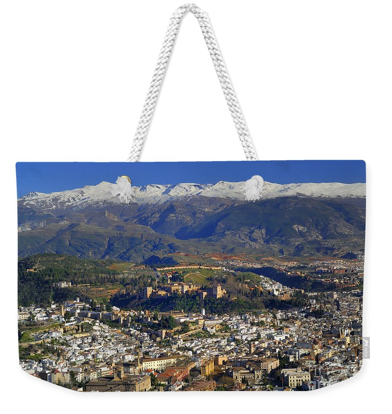 Lthe Alhambra Weekender Tote Bag featuring the photograph Granada And The Alhambra by Guido Montanes Castillo