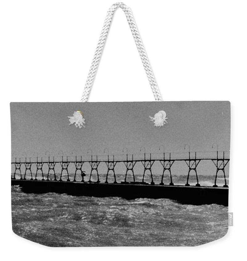 Weekender Tote Bag featuring the photograph Grand Haven Light In Black And White by Daniel Thompson