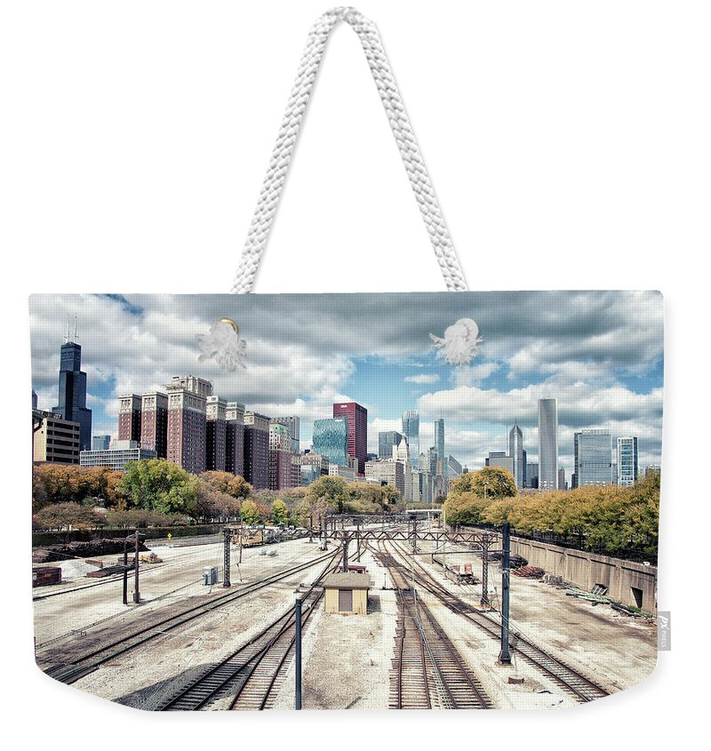 Tranquility Weekender Tote Bag featuring the photograph Grant Park Railroad Tracks by Photographer Who Enjoys Experimenting With Various Styles.