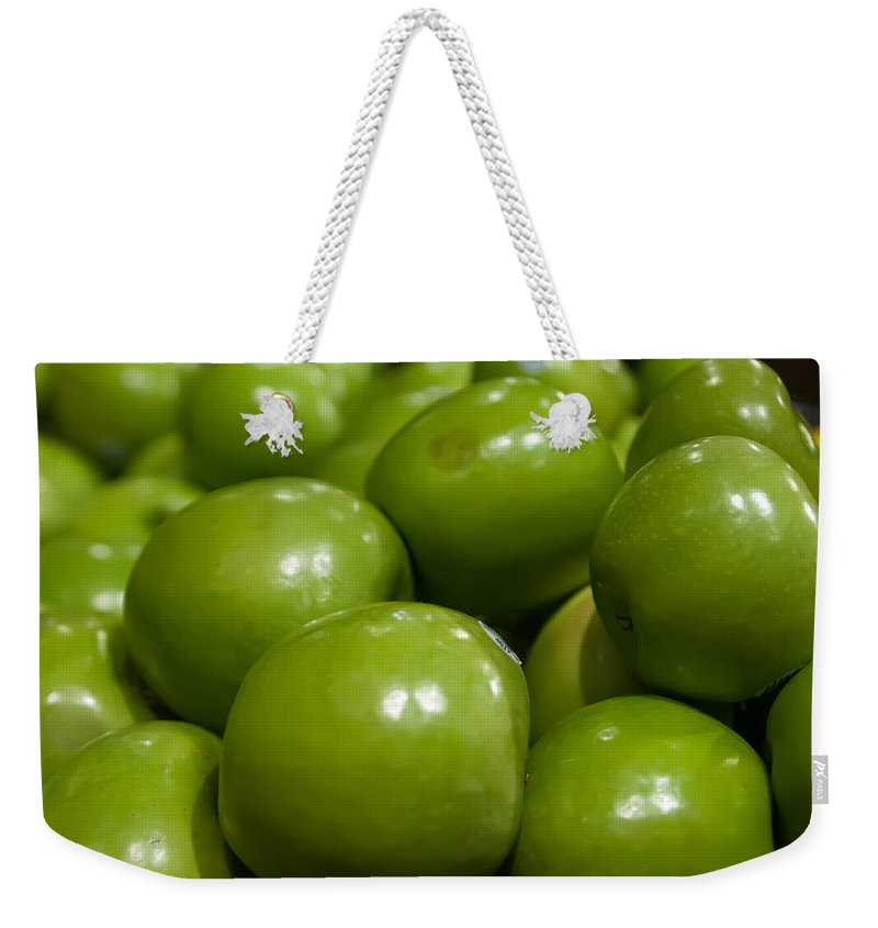 Agriculture Weekender Tote Bag featuring the photograph Green Apples On Display At Farmers Market by Alex Grichenko