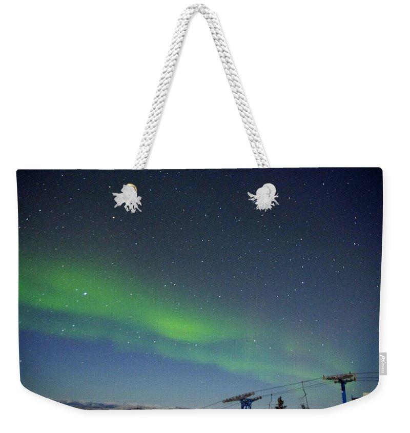 Alaska Aurora Borealis Weekender Tote Bag featuring the photograph Green Lady Dancing 13 by Phyllis Spoor