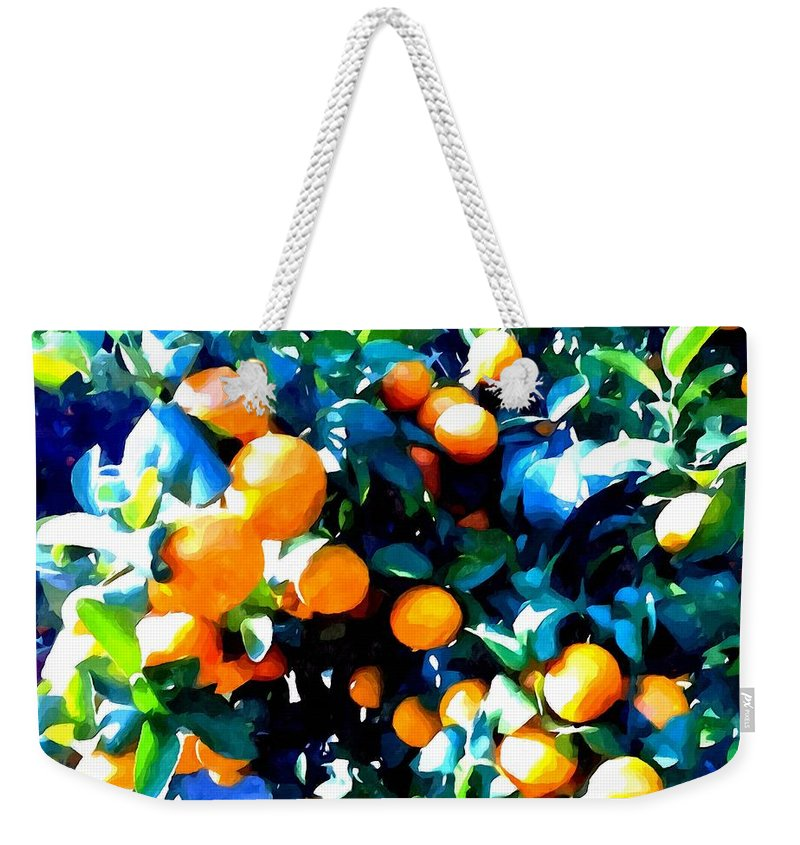 Agricultural Weekender Tote Bag featuring the painting Green Leaves And Mature Oranges On The Tree by Jeelan Clark
