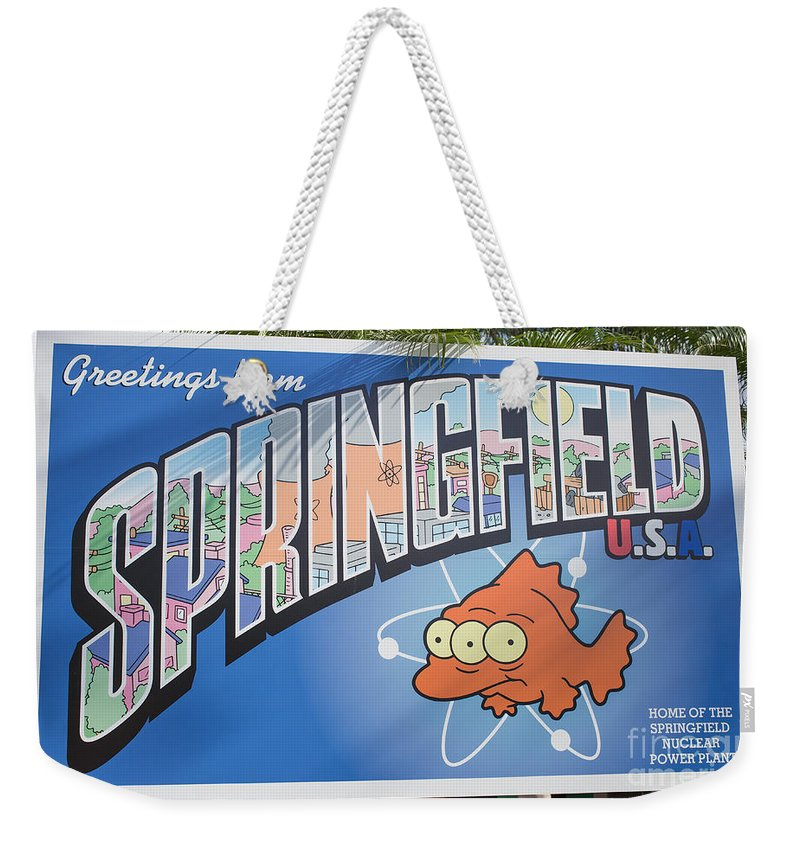 Florida Weekender Tote Bag featuring the photograph Greeting From Springfield Usa by Edward Fielding