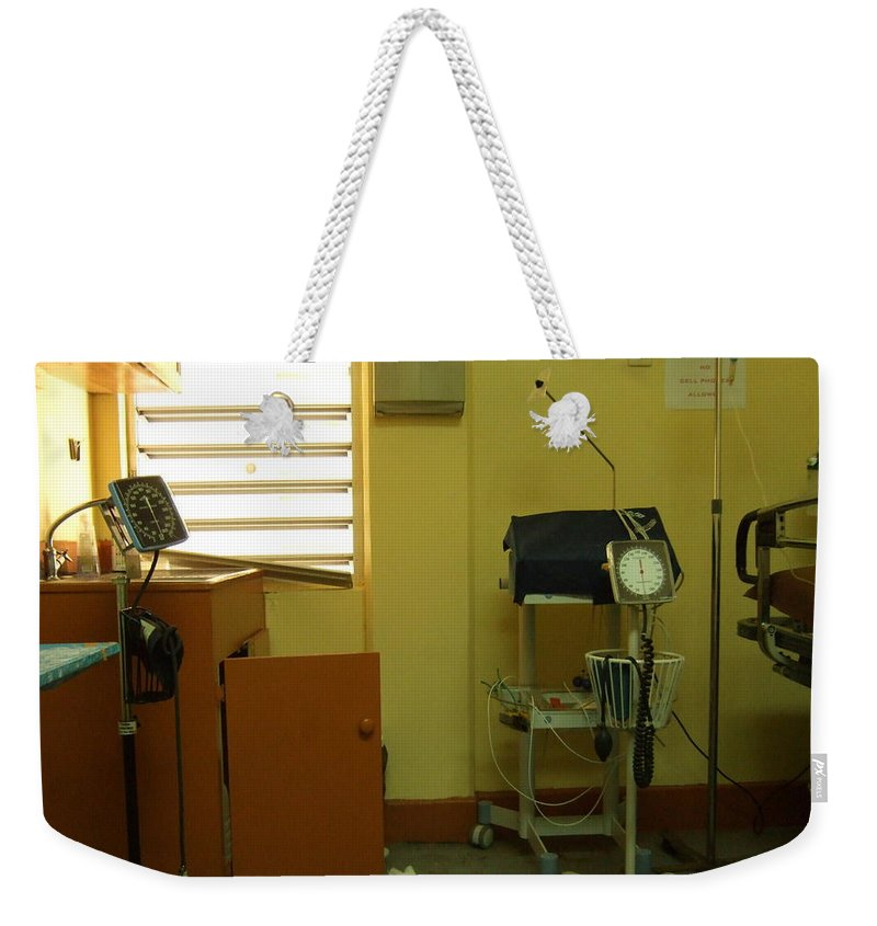 Weekender Tote Bag featuring the photograph Grenada Hospital's Er by Katerina Naumenko