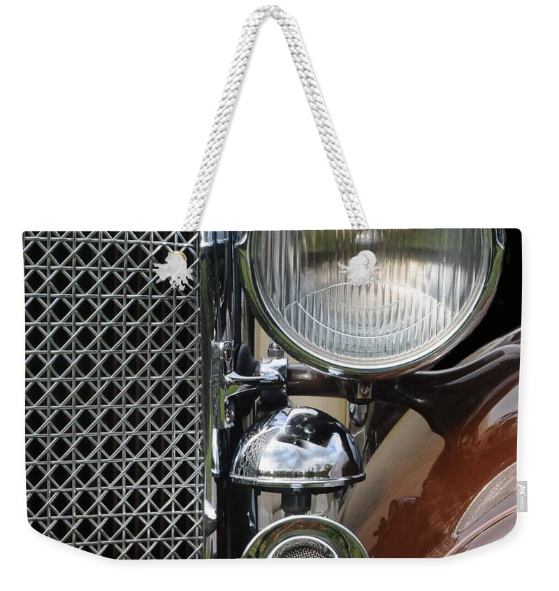Car Weekender Tote Bag featuring the photograph Grill And Headlight by Dave Mills