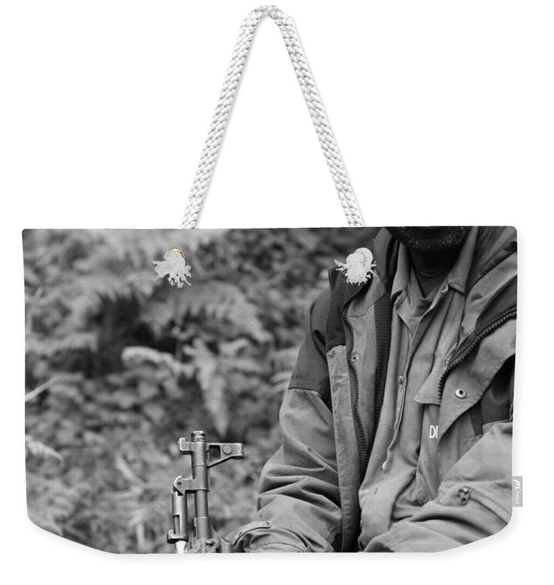 Rwanda Weekender Tote Bag featuring the photograph Guardian Of The Mountain Gorillas by Bruce J Robinson