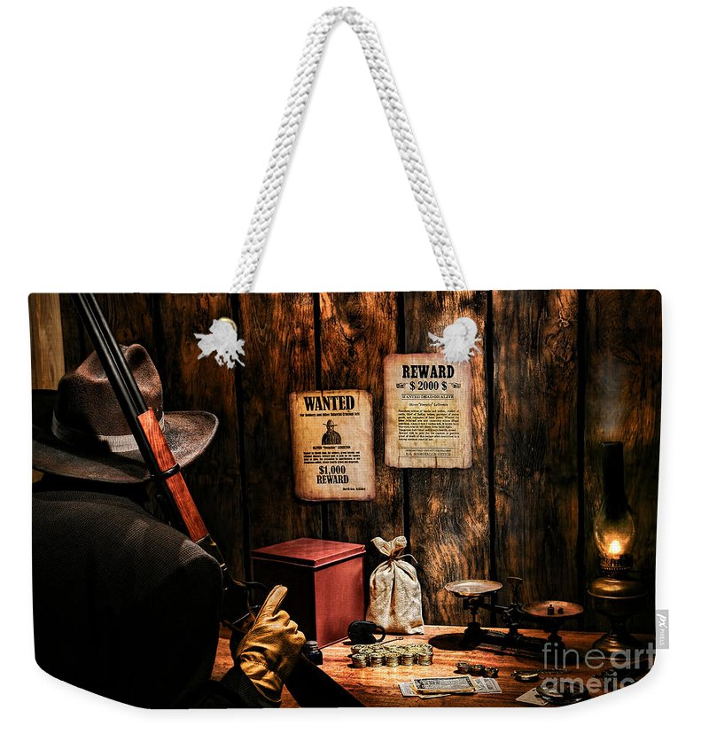 Western Weekender Tote Bag featuring the photograph Guarding The Payroll by Olivier Le Queinec