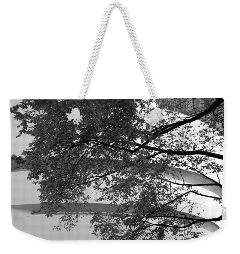 Scenic Weekender Tote Bag featuring the photograph Guggenheim And Trees In Black And White by Rob Hans