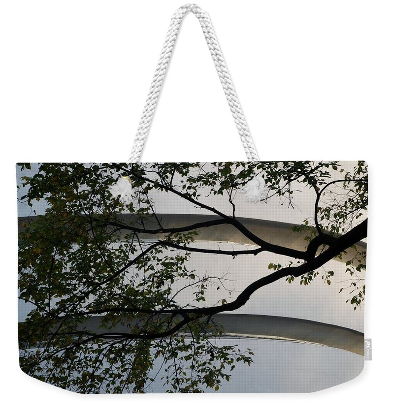 Scenic Weekender Tote Bag featuring the photograph Guggenheim And Trees by Rob Hans