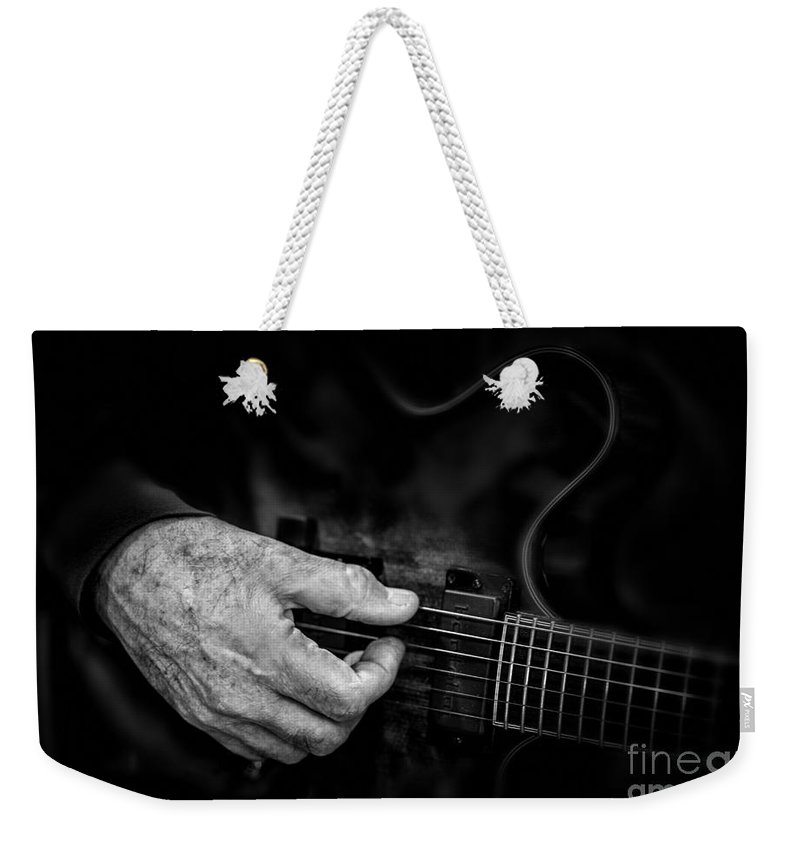 Guitar Weekender Tote Bag featuring the photograph Guitar And Hand Bw by Jerry Fornarotto