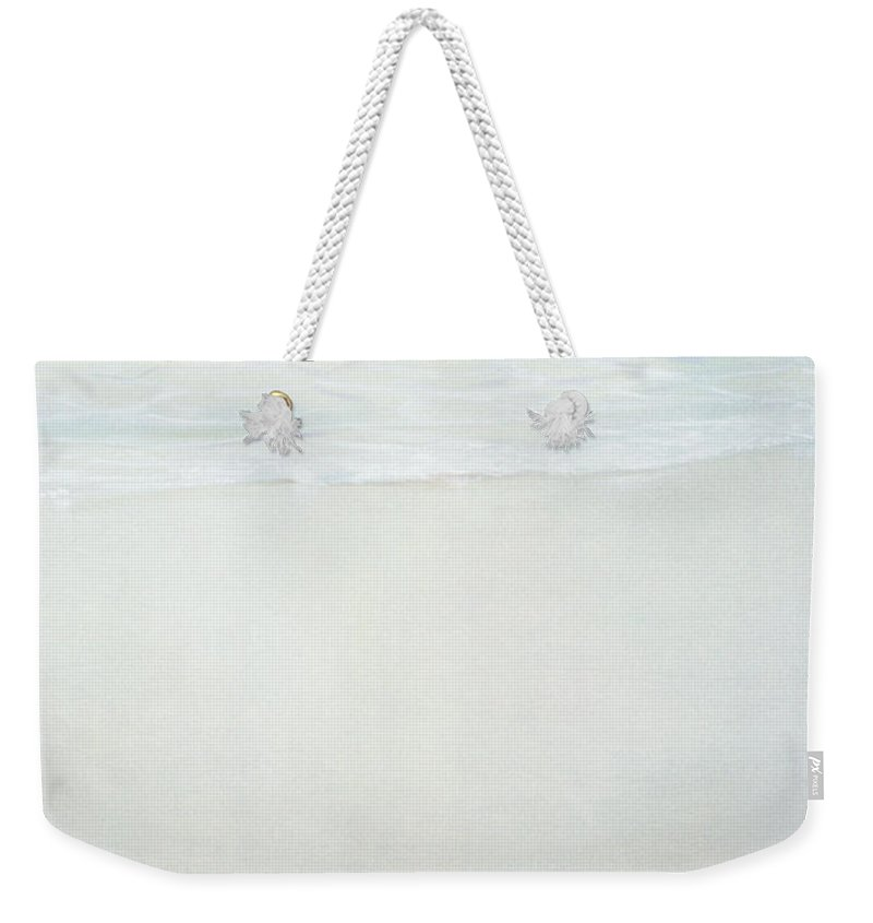 Green Flash Weekender Tote Bag featuring the photograph Gym Shoes On Beach by Lincoln Seligman