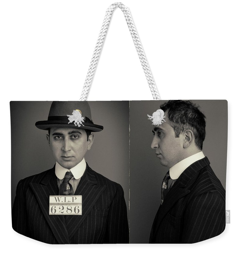 Guilt Weekender Tote Bag featuring the photograph Hakan The Boss Wanted Mugshot by Nick Dolding