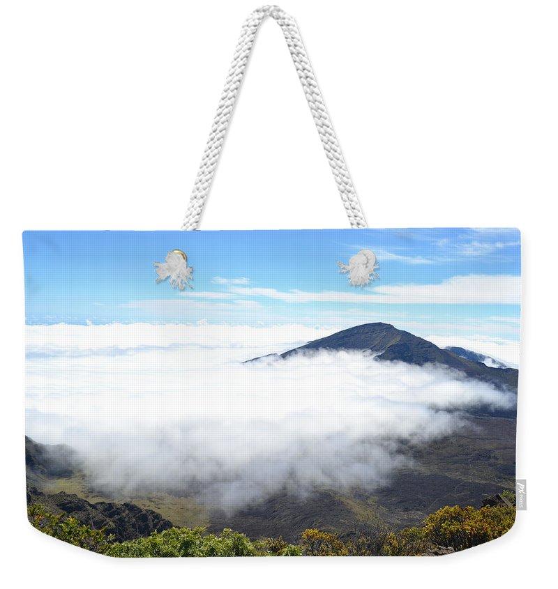Haleakala Weekender Tote Bag featuring the photograph Haleakala Clouds Moving In by Christine Owens