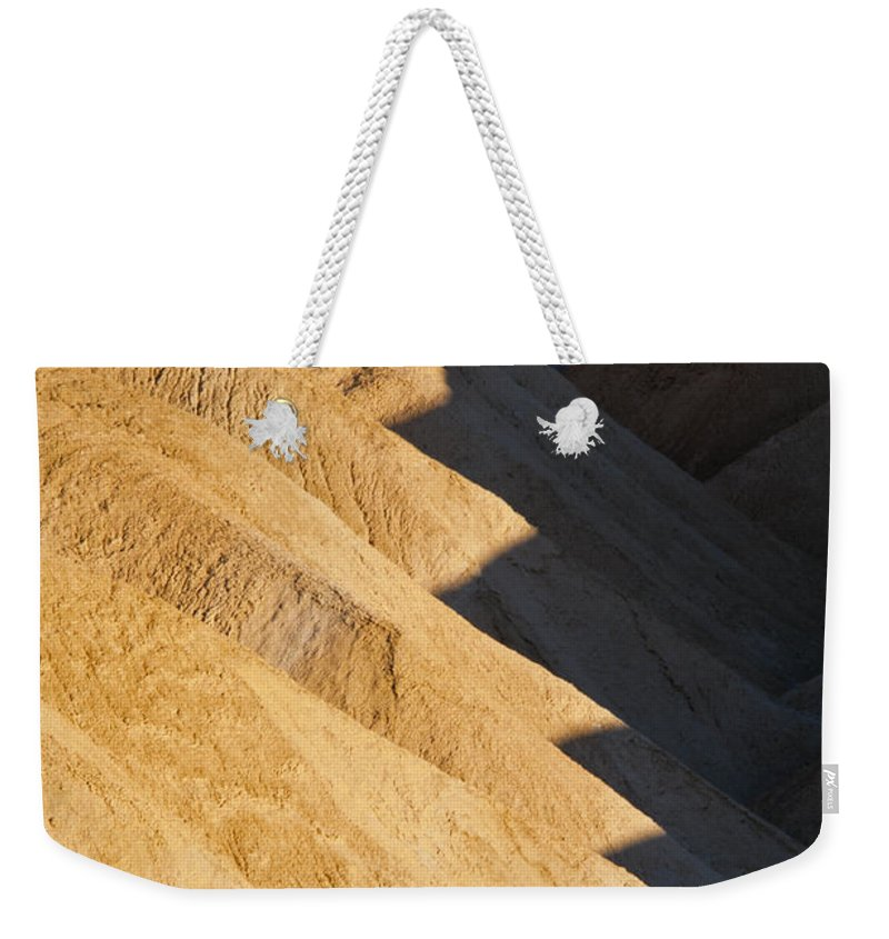 Zabriskie Point Death Valley National Park California Parks Mountain Mountains Desert Desert Ridge Ridges Light And Shadow Shadows Peak Peaks Sand Rock Landscape Landscapes Desertscape Desertscapes Weekender Tote Bag featuring the photograph Half And Half by Bob Phillips