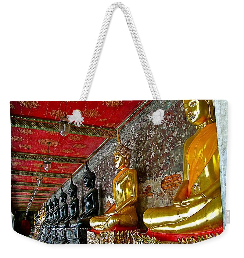 Hall Of Buddhas In Wat Suthat In Bangkok Weekender Tote Bag featuring the photograph Hall Of Buddhas At Wat Suthat In Bangkok-thailand by Ruth Hager