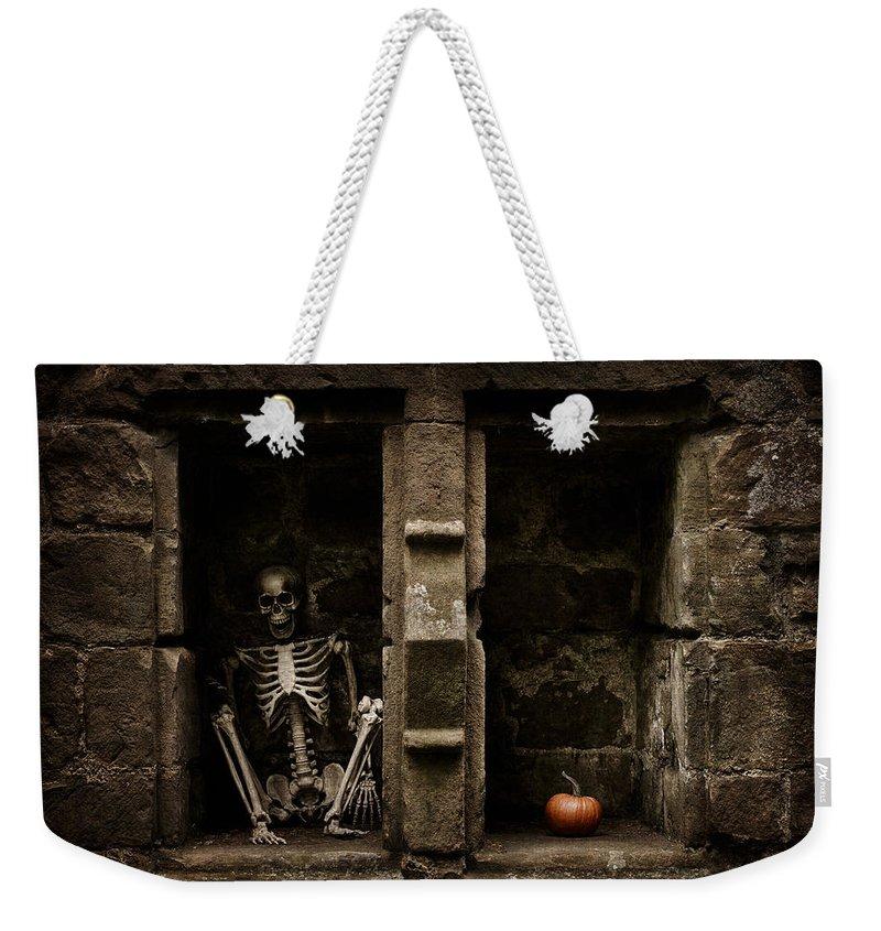 Skeleton Weekender Tote Bag featuring the photograph Halloween Skeleton by Amanda Elwell