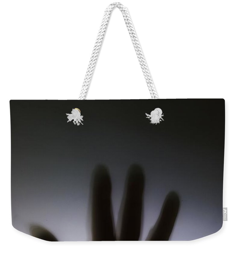 Danger Weekender Tote Bag featuring the photograph Hand Against A Window by Simon Bratt Photography LRPS