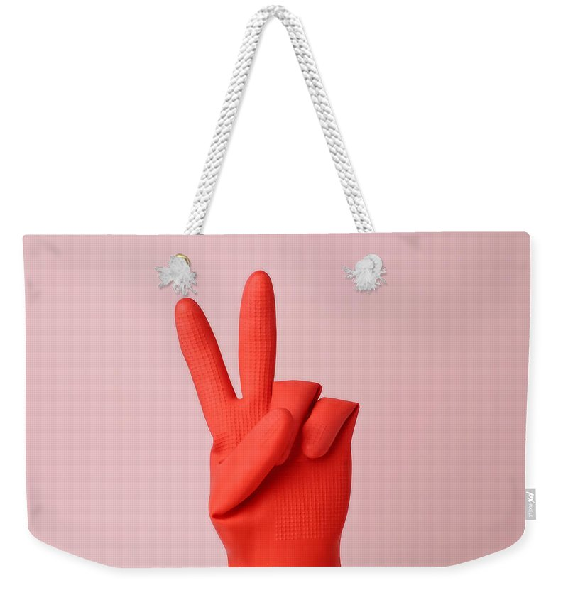 Washing Up Glove Weekender Tote Bag featuring the photograph Hand In Red Rubber Glove Making Peace by Juj Winn