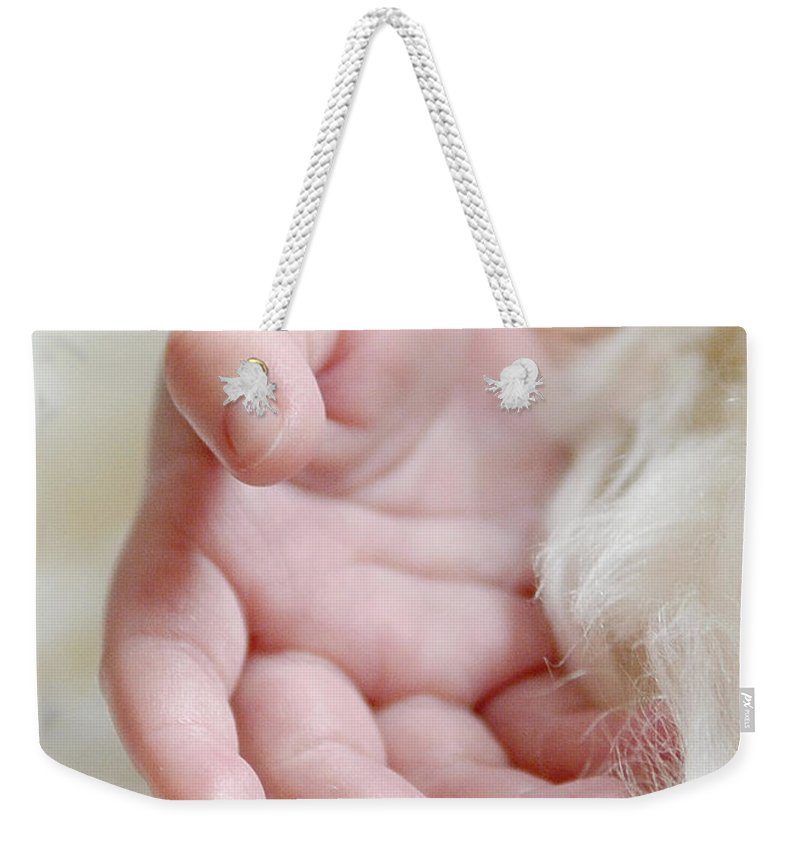 Baby Weekender Tote Bag featuring the photograph Hand Of An Angel by Lisa Phillips