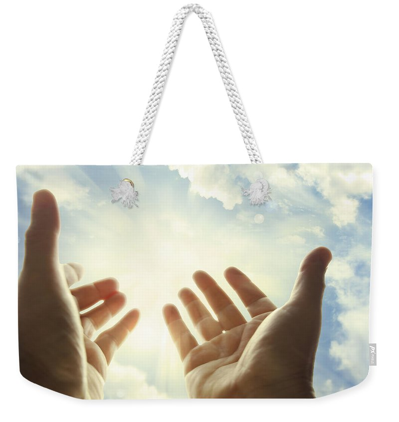 Seek Weekender Tote Bag featuring the photograph Hands In Sky by Les Cunliffe