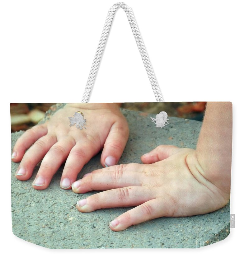 Baby Weekender Tote Bag featuring the photograph Hands Of Our Future by Jennifer Lavigne
