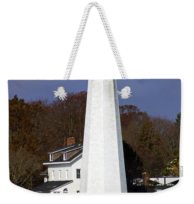 New London Weekender Tote Bag featuring the photograph Harbor Light by Joe Geraci
