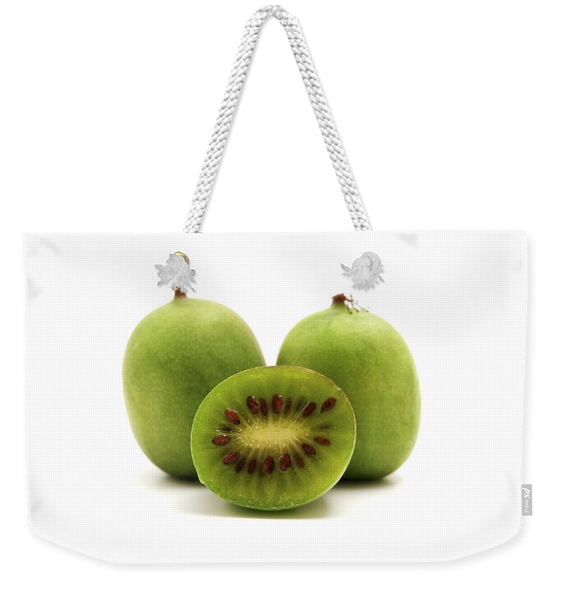 White Background Weekender Tote Bag featuring the photograph Hardy Kiwifruit by Fabrizio Troiani