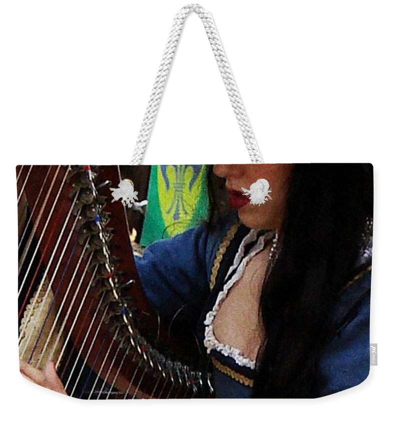 Harpist Weekender Tote Bag featuring the photograph Harpist by Rodney Lee Williams