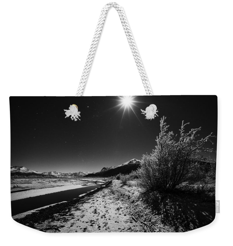 Knik River Weekender Tote Bag featuring the photograph Harsh Reality by Ted Raynor