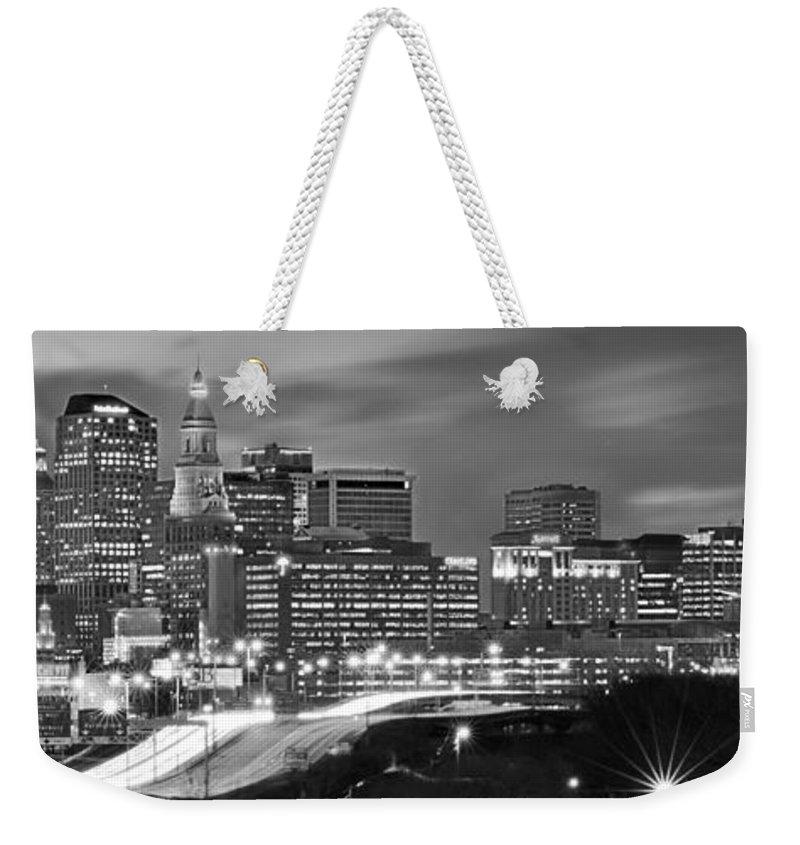 Hartford Skyline At Night Weekender Tote Bag featuring the photograph Hartford Skyline At Night Bw Black And White Panoramic by Jon Holiday