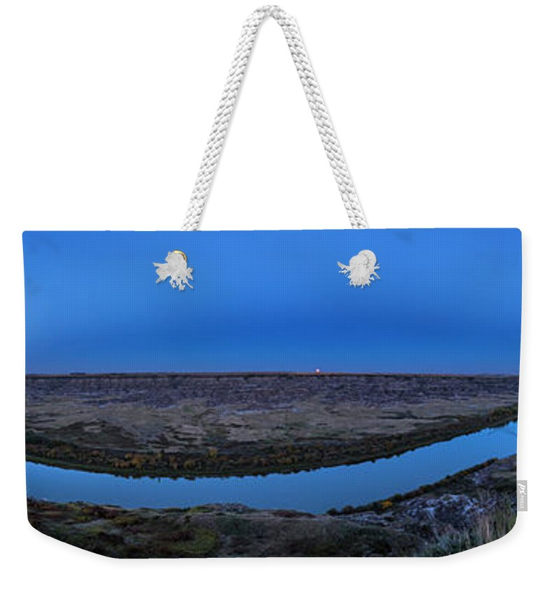 Alberta Weekender Tote Bag featuring the photograph Harvest Moon Rising Over The Red Deer by Alan Dyer