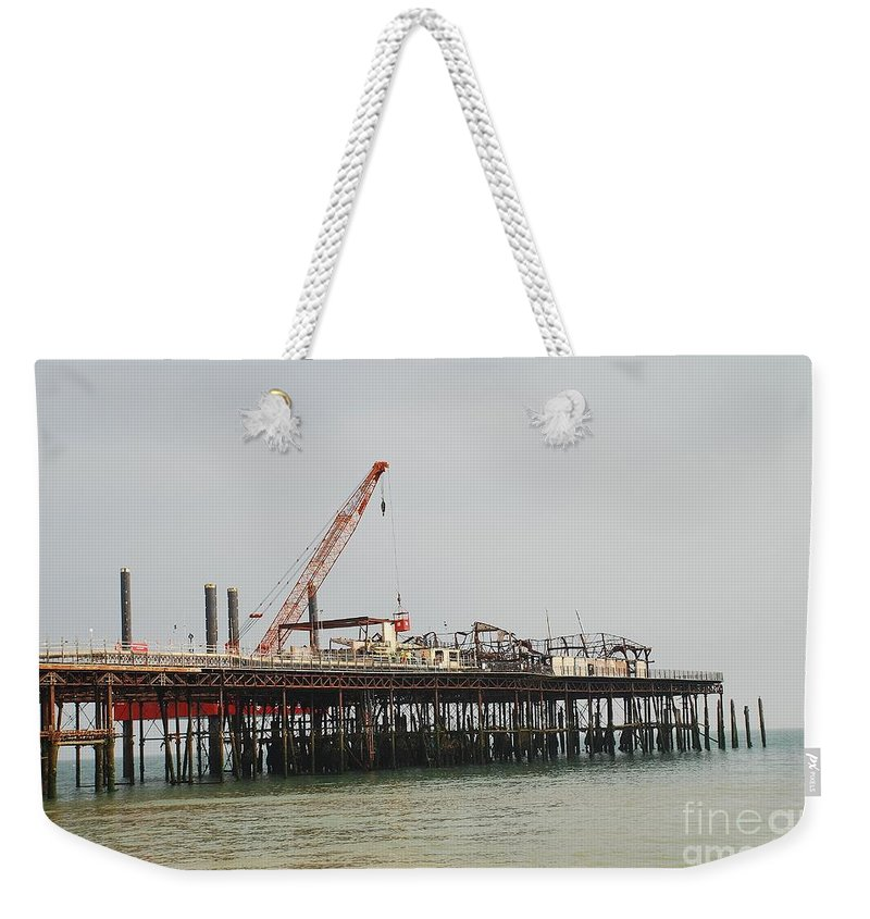 Hastings Weekender Tote Bag featuring the photograph Hastings Pier Reconstruction by David Fowler