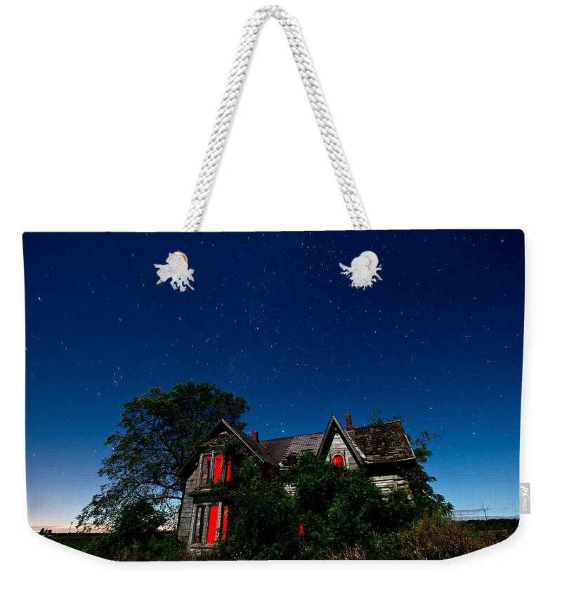 Abandoned Weekender Tote Bag featuring the photograph Haunted Farmhouse At Night by Cale Best