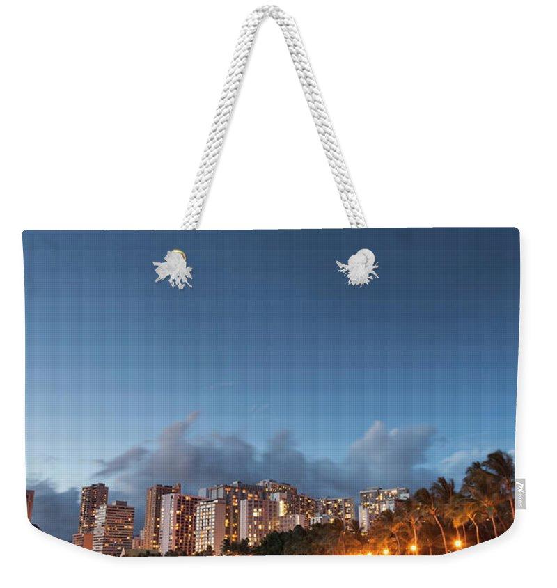 Honolulu Weekender Tote Bag featuring the photograph Hawaii, Oahu, Honolulu by Michele Falzone