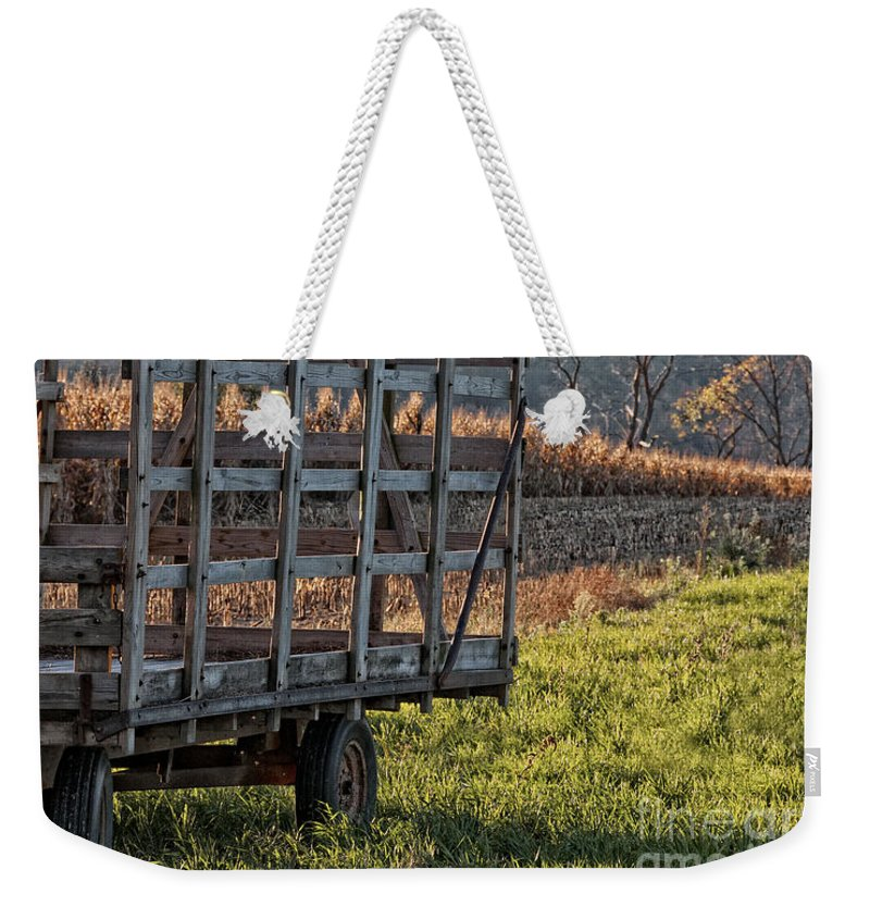 Hay Wagon Weekender Tote Bag featuring the photograph Hay Wagon In Field by Timothy Flanigan and Debbie Flanigan Nature Exposure