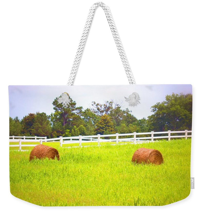 Hayrolls Weekender Tote Bag featuring the photograph Hayrolls And Fences by Tara Potts