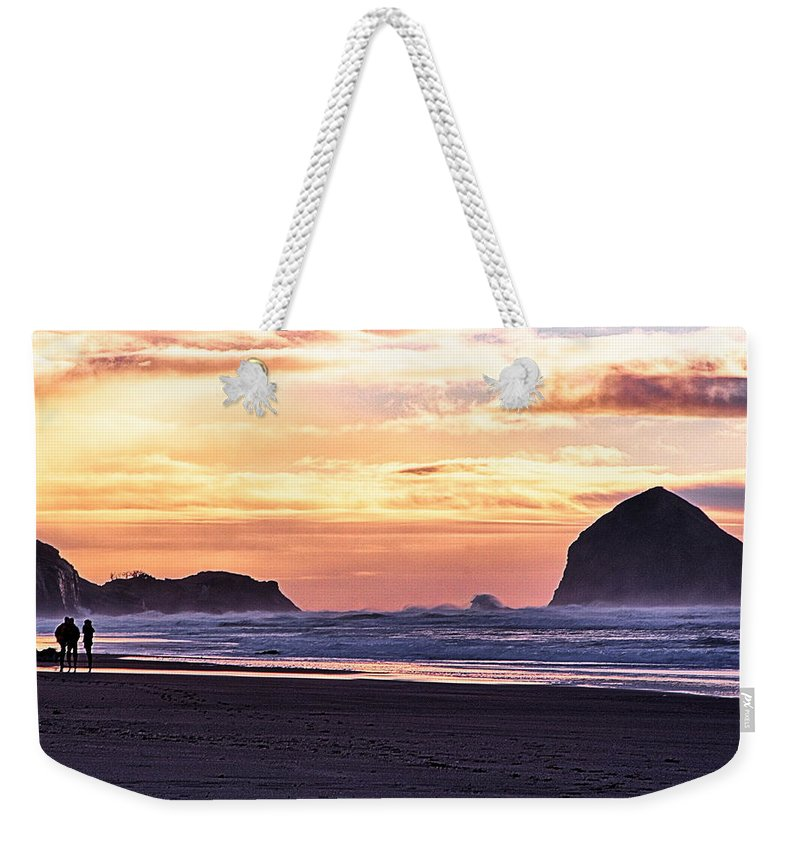 Haystack Rock Weekender Tote Bag featuring the photograph Haystack Rock Beach Walk Sunset by Chriss Pagani