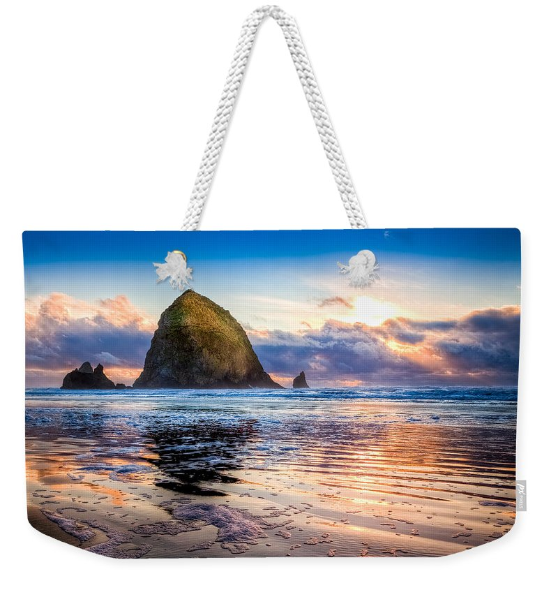 Oregon Weekender Tote Bag featuring the photograph Haystack Rock by Niels Nielsen