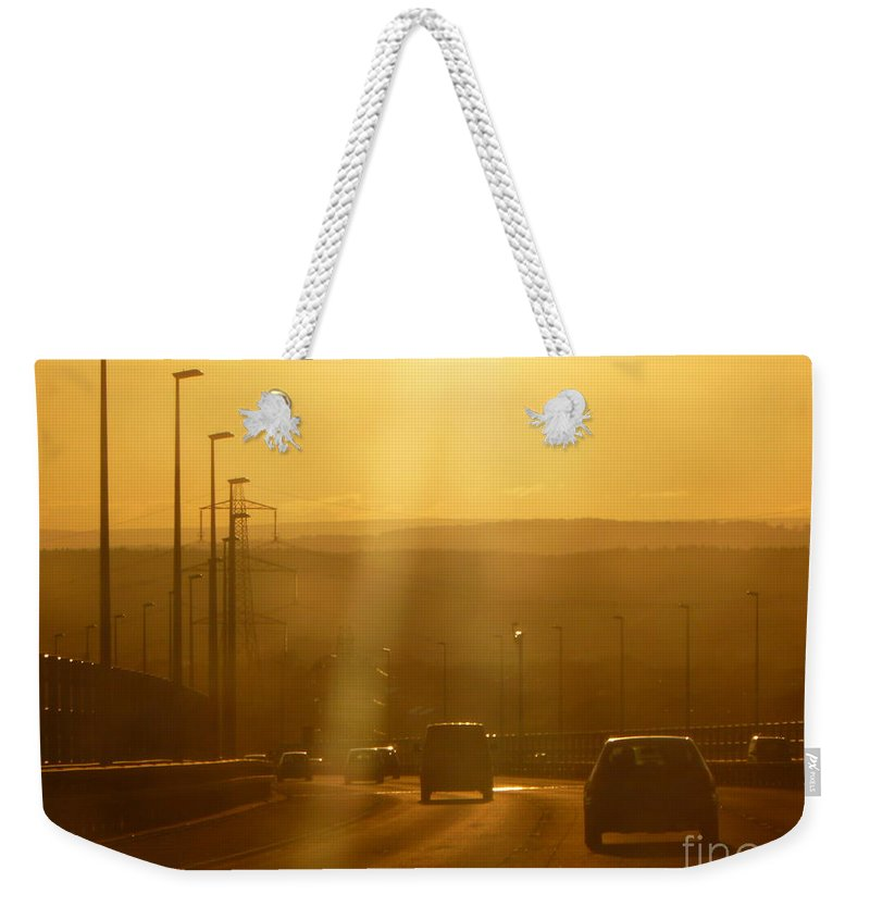 Driving Weekender Tote Bag featuring the photograph Heading Home by Vicki Spindler