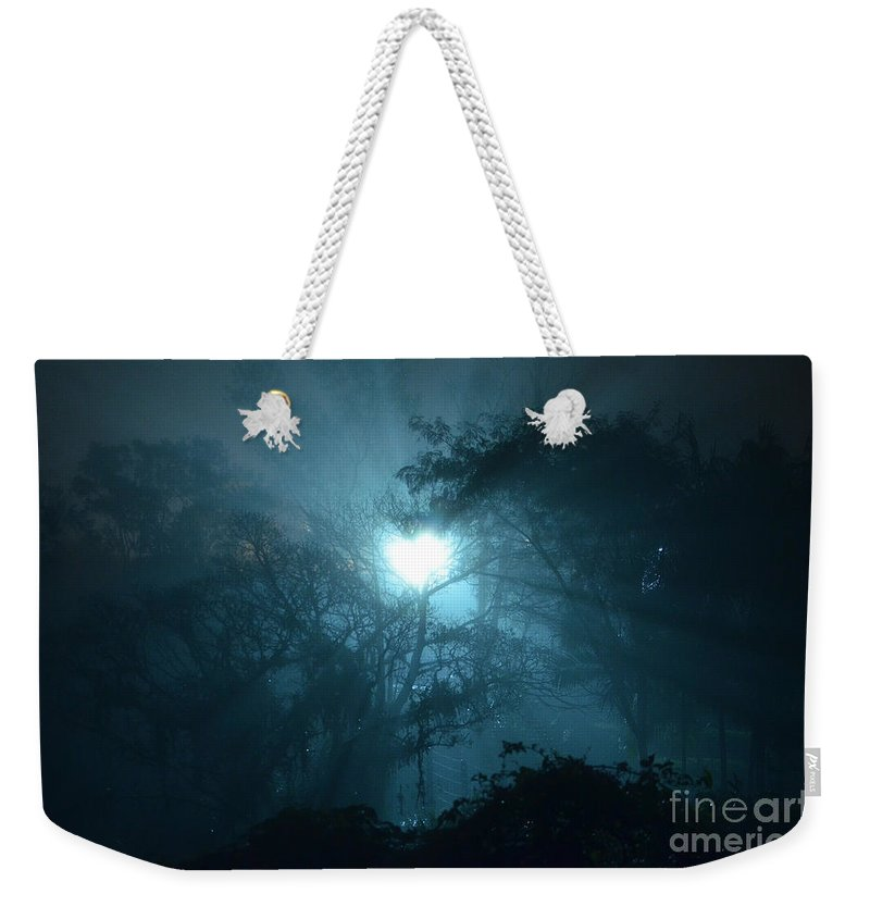 Forest Weekender Tote Bag featuring the photograph Heart Of Light On A Foggy Night Sky by Carlos Alkmin