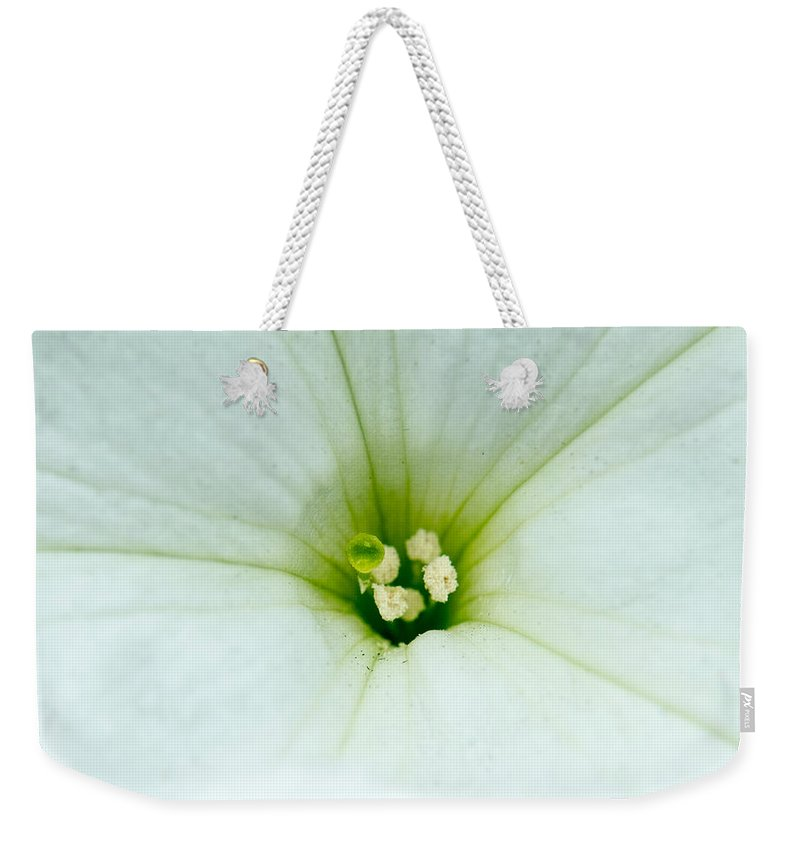 Alberta Weekender Tote Bag featuring the photograph Heart Of The Petunia by Douglas Barnett
