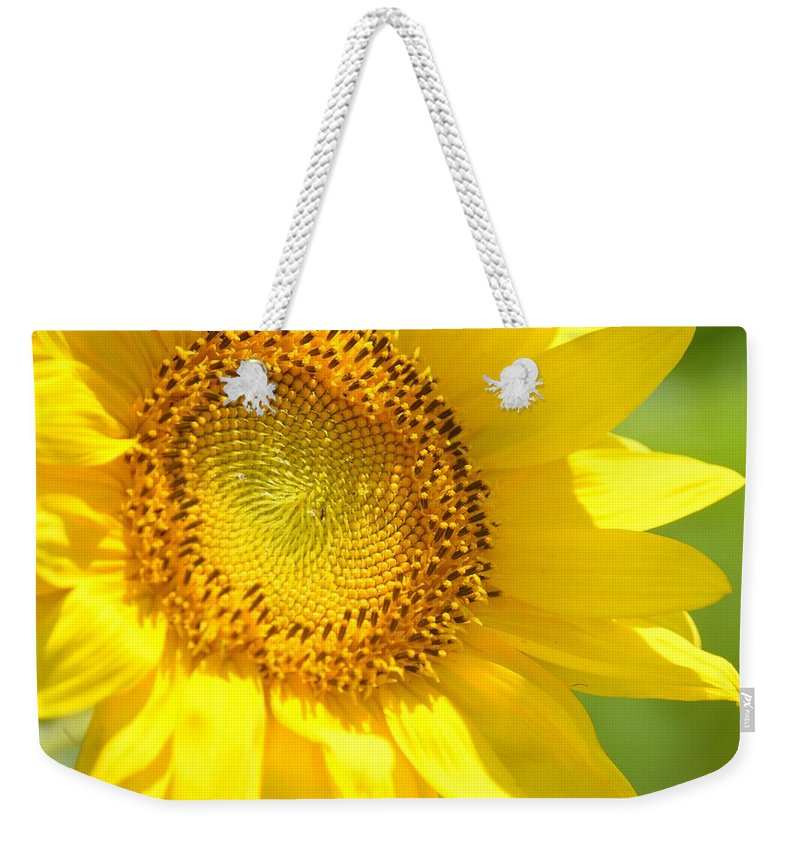 Heart Of The Sunflower Weekender Tote Bag featuring the photograph Heart Of The Sunflower by Maria Urso