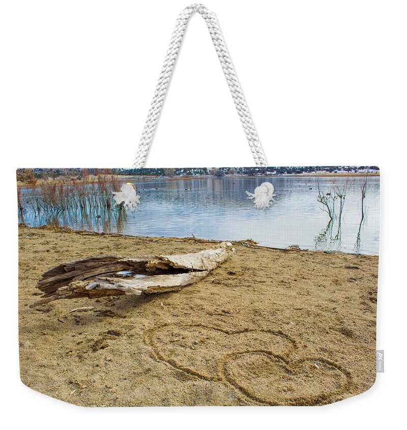 Nature Weekender Tote Bag featuring the photograph Hearts Drifting by Phyllis Bradd
