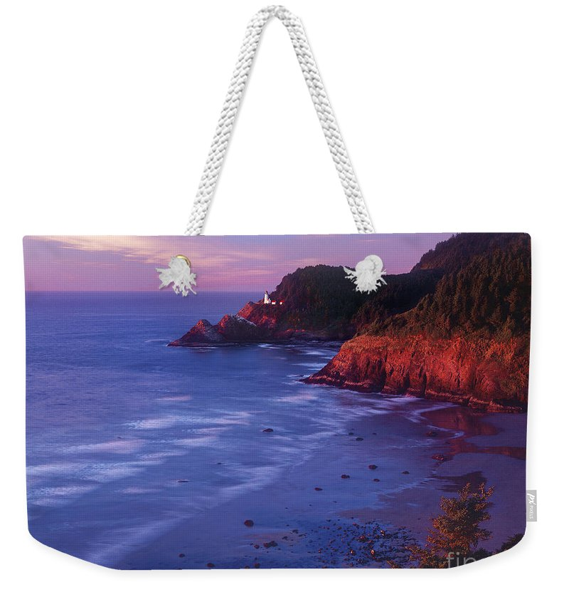 North America Weekender Tote Bag featuring the photograph Heceta Head Lighthouse At Sunset Oregon Coast by Dave Welling