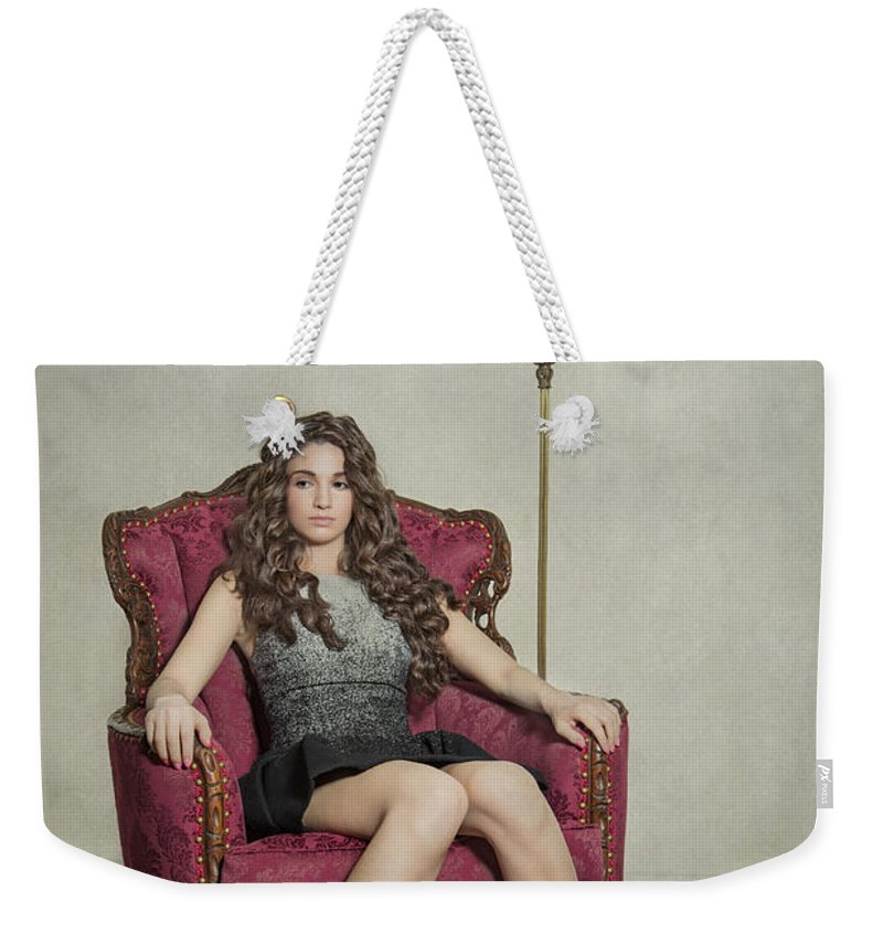 Girl Weekender Tote Bag featuring the photograph Her Majesty by Evelina Kremsdorf
