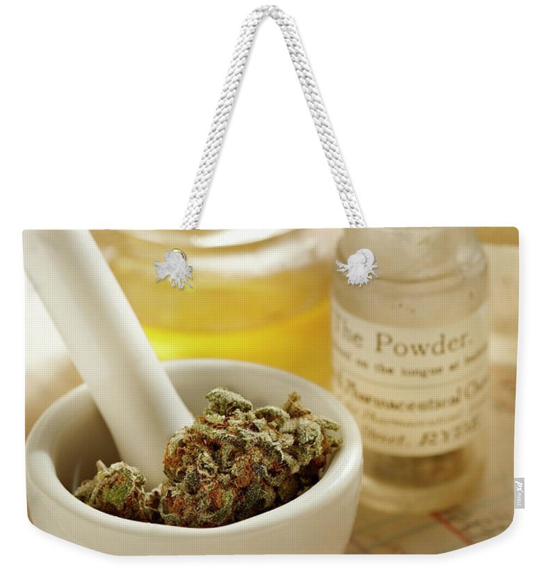 Mortar And Pestle Weekender Tote Bag featuring the photograph Herbal Medicine by Lew Robertson