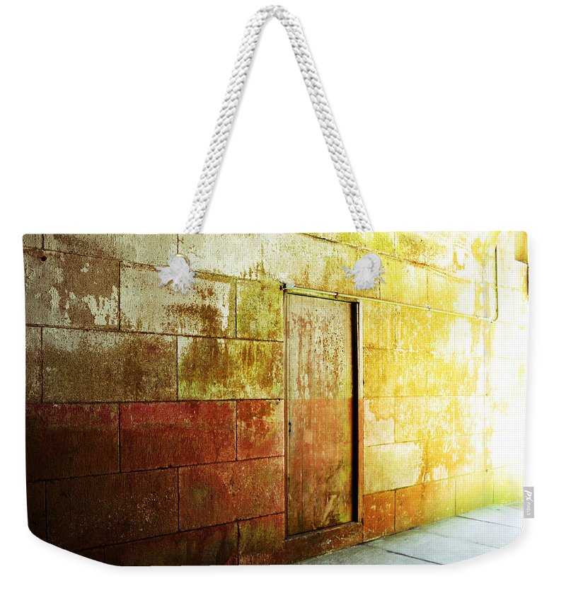 Brick Weekender Tote Bag featuring the photograph Hidden Door by Holly Blunkall